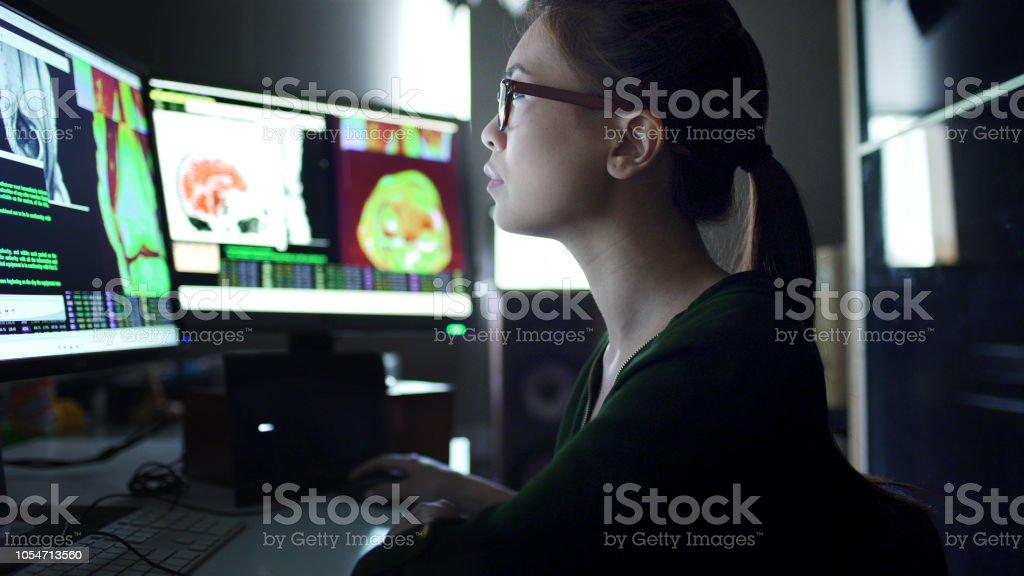 Watching physiology screens stock photo