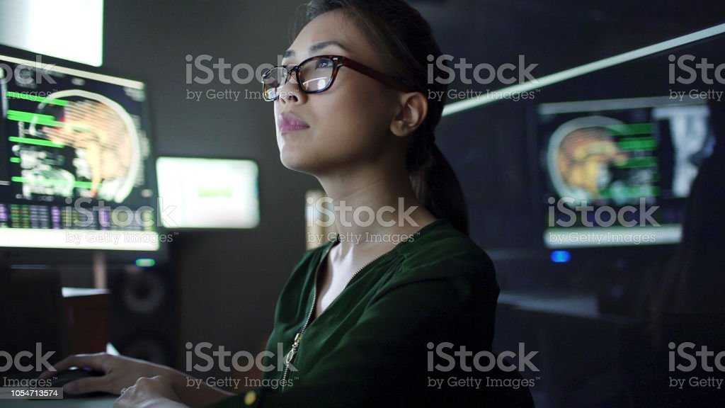 Close up stock image of a young asian woman working at a desk with...