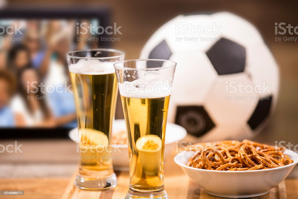 watching soccer game on television snacks beer ball stock photo