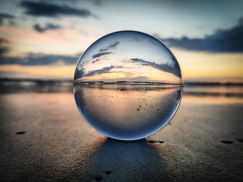 Watching sunrise throught a lens ball - Riviera Romagnola