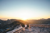 istock Watching Sunset From The Church 1198060489