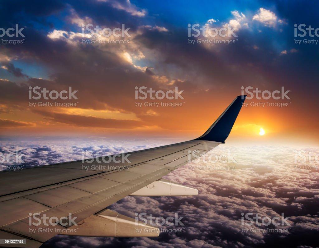 Watching sunset on flight stock photo