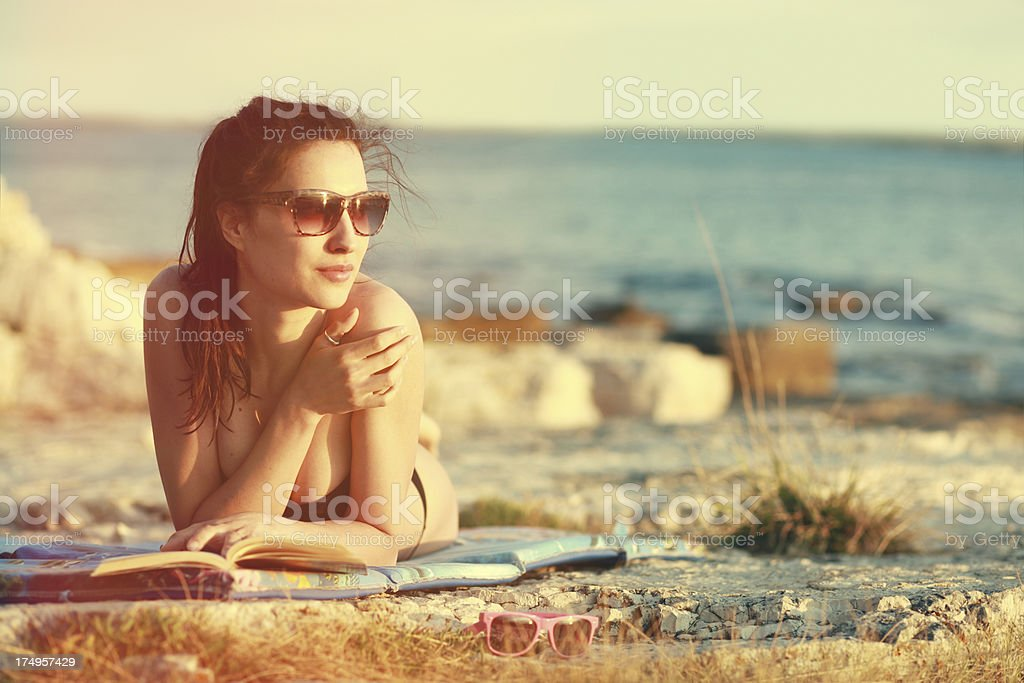 Watching sunset on the beach royalty-free stock photo