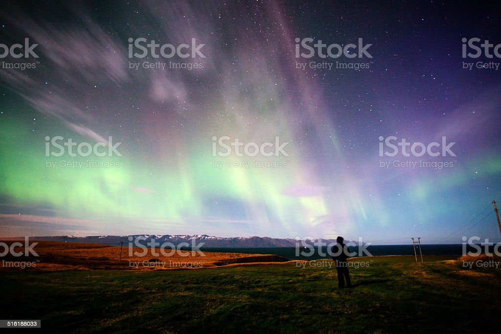 Watching the Aurora Borealis stock photo