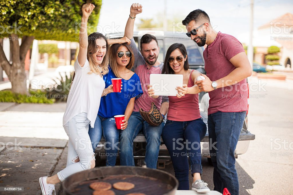 Watching the baseball game on a tablet stock photo