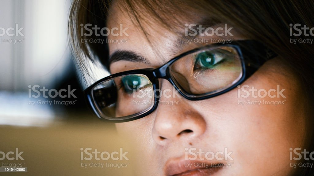 No distractions when her\'s in work mode Woman wearing glasses looking...