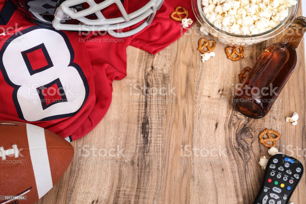 Watching the football game with snacks, drinks. stock photo