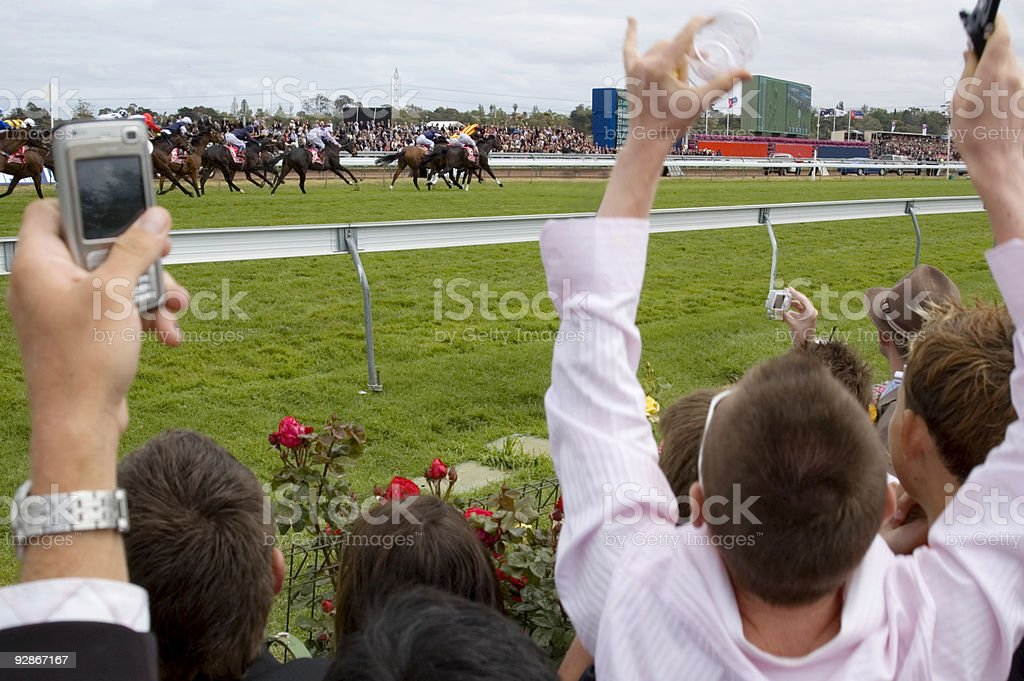 Watching the Horse Races stock photo