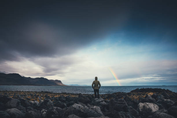 Watching The Rainbow In Iceland stock photo