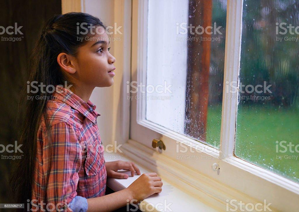 Watching the raindrops stock photo