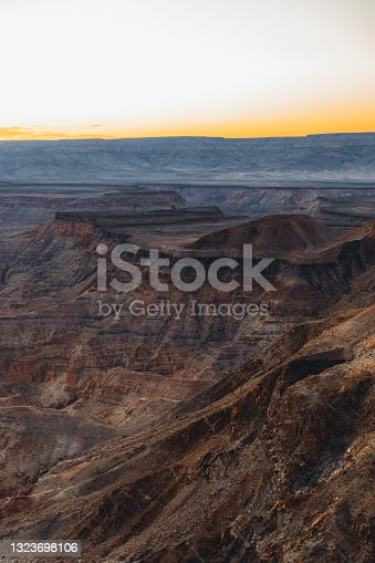 Dramatic panoramic view of the huge canyon with curved river during sunny colorful sunset in Namibia, Southern Africa