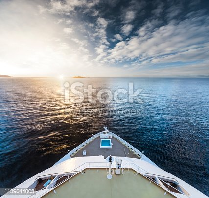 istock Watching the sunrise at Cruise Ship Bow 1139044008
