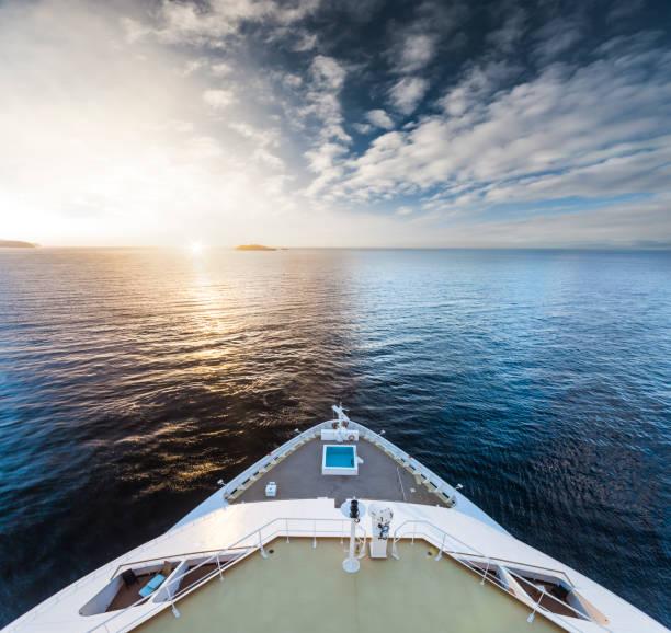 Watching the sunrise at Cruise Ship Bow stock photo
