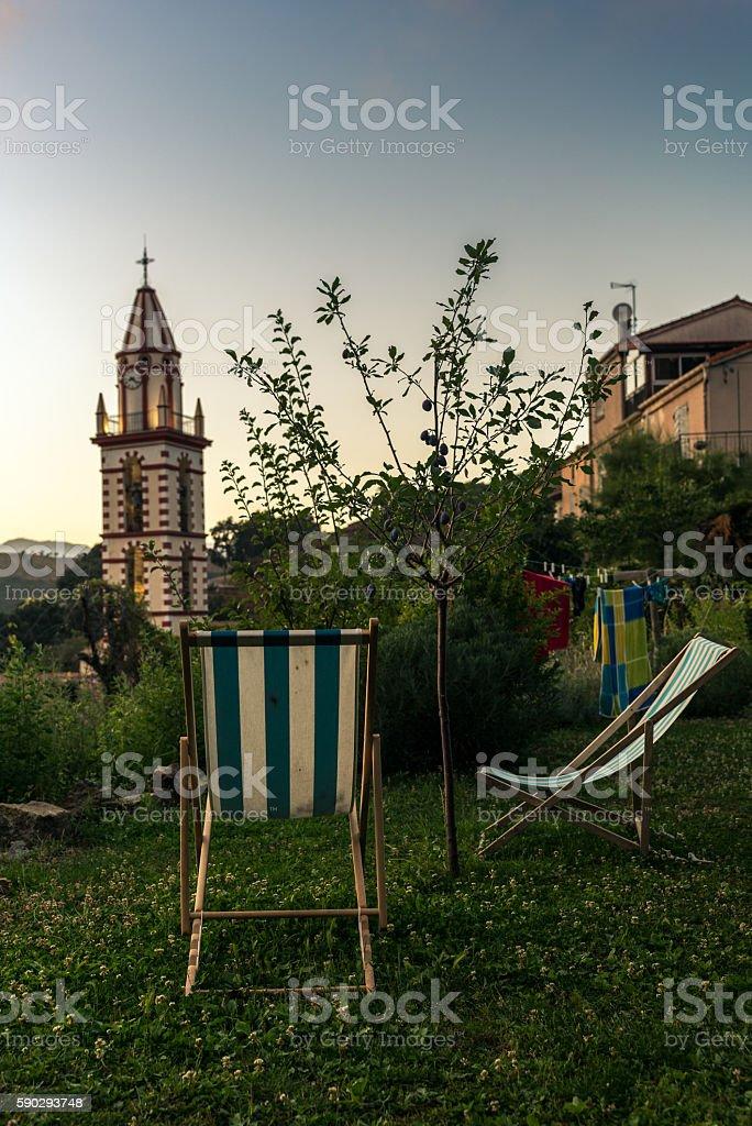 Watching the sunset in a village of Corsica - 1 royaltyfri bildbanksbilder