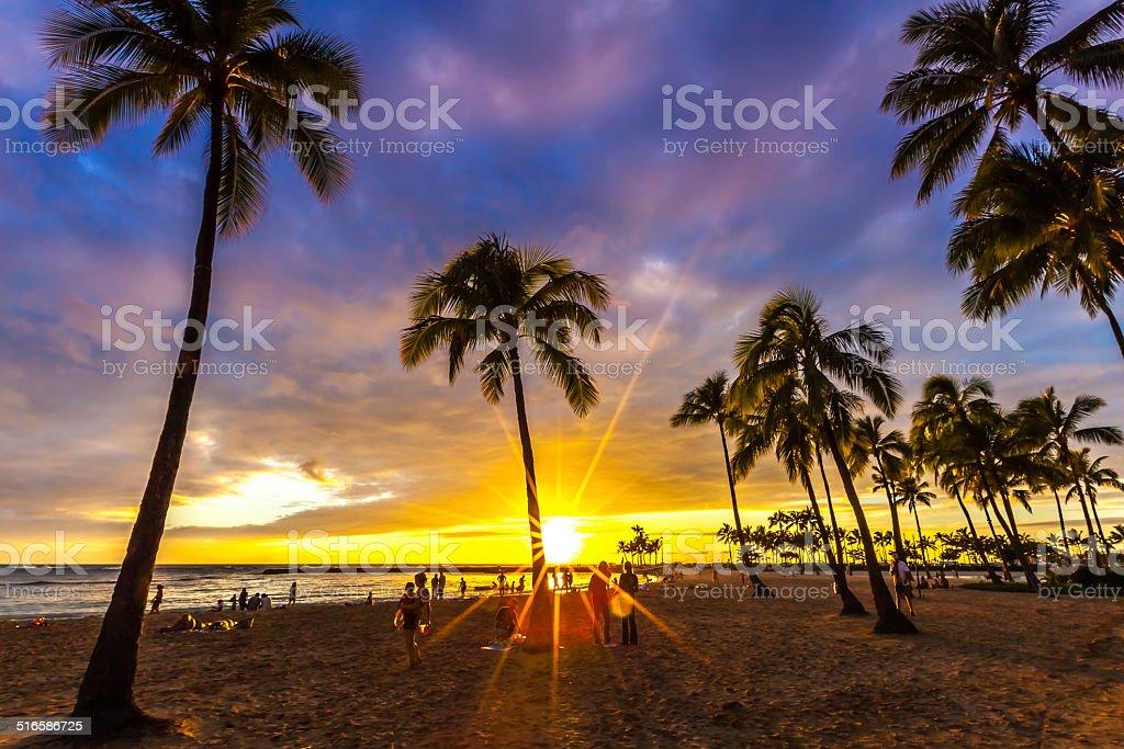 Watching the sunset in Waikiki stock photo