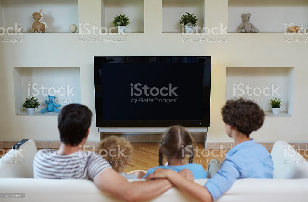 Watching tv as leisure for family stock photo