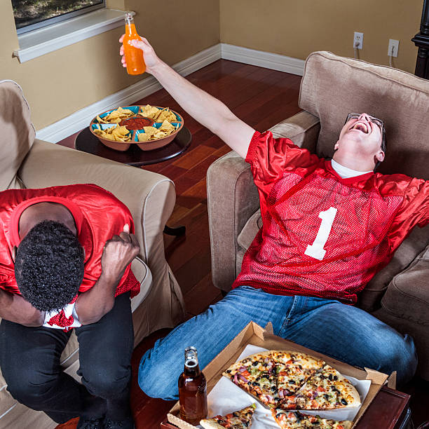 watching tv football,  ecstasy of victory and agony of defeat - football friends tv night stockfoto's en -beelden