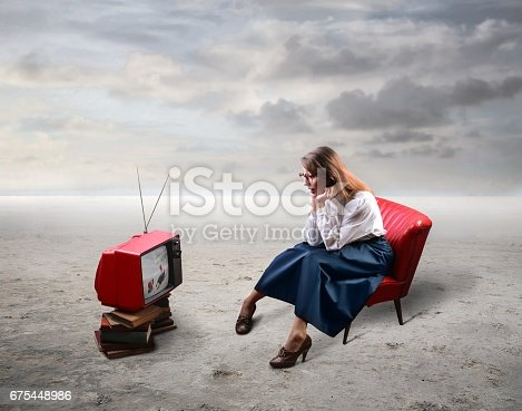 istock Watching TV in the middle of nowhere 675448986