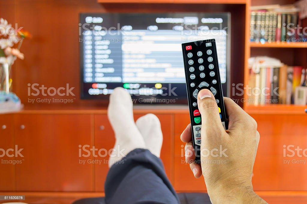 watching tv programming stock photo