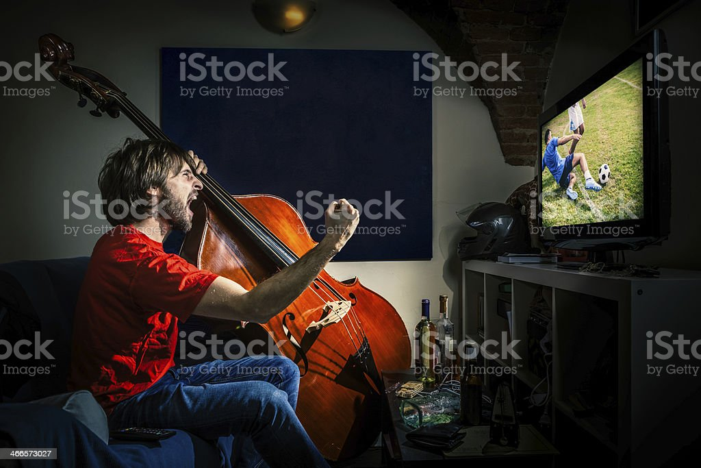 Watching TV with a Double Bass, Living for Music stock photo