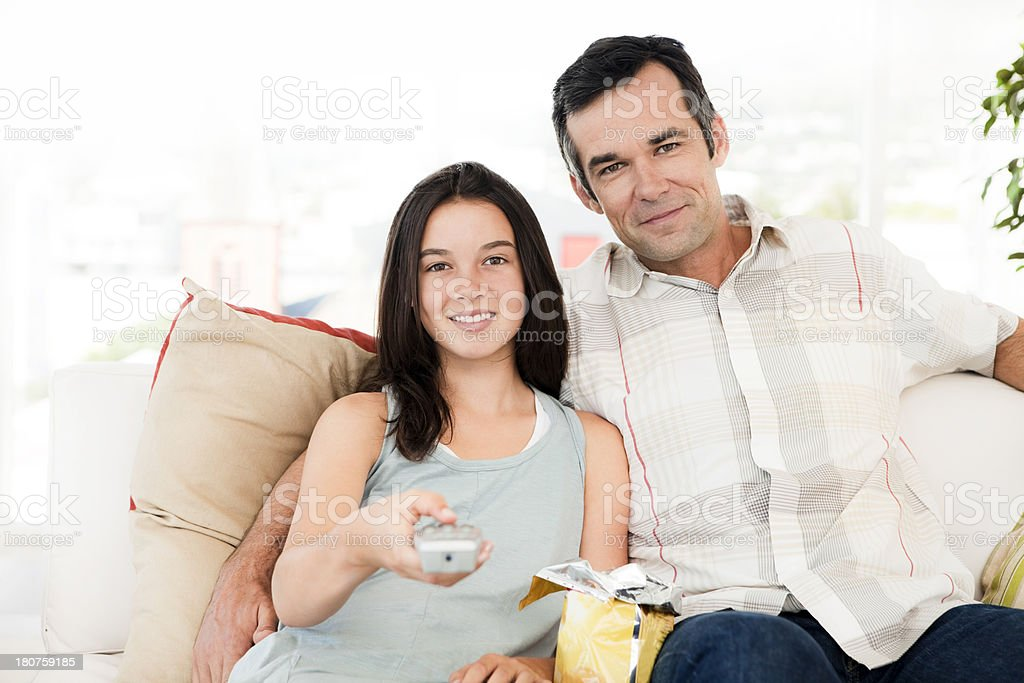 Watching tv with dad royalty-free stock photo