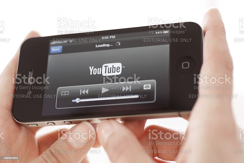 Watching Youtube Video on Iphone 4 stock photo