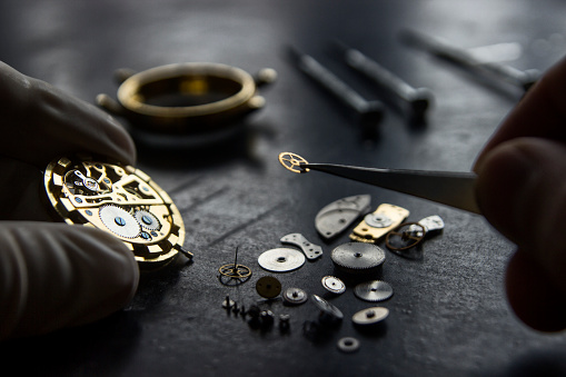 istock Watchmaker is repairing the mechanical watches in his workshop 937088398