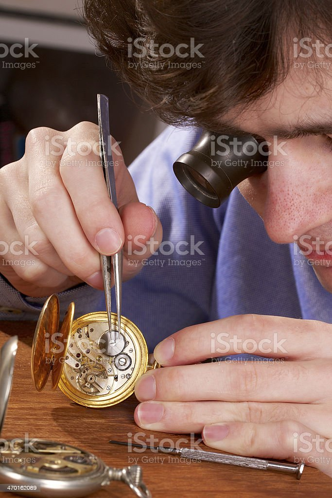 Watchmaker Repairing a Pocket Watch stock photo