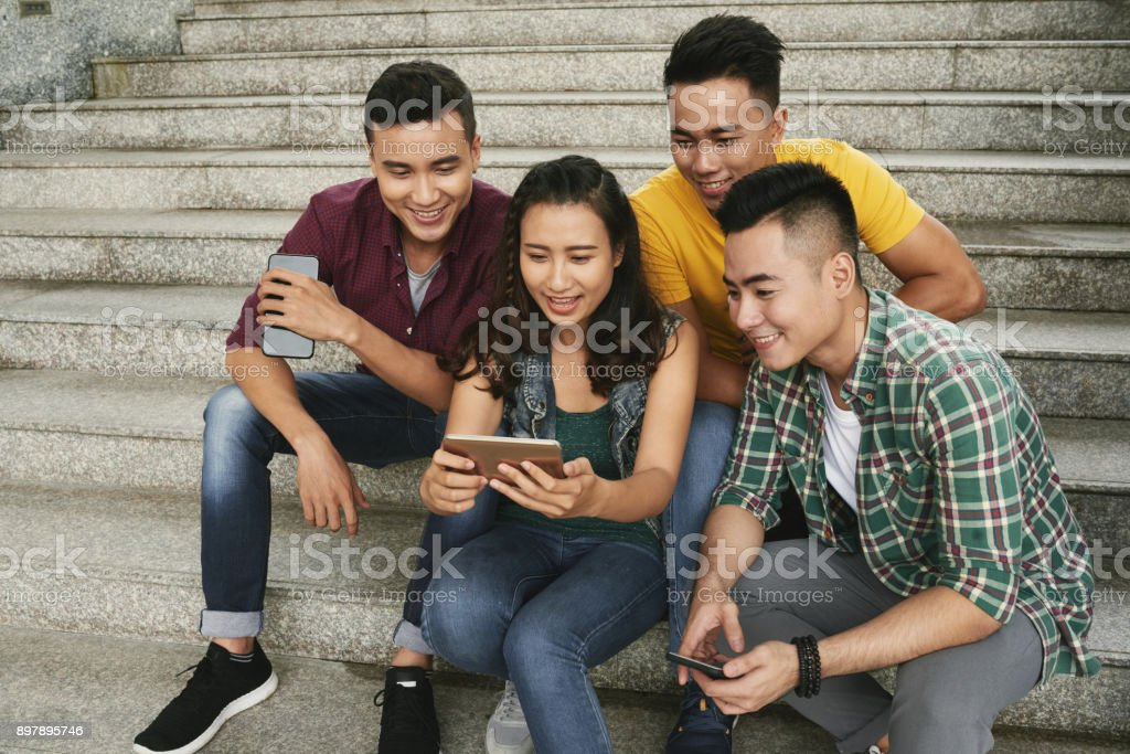 Watching Videos Together Stock Photo More Pictures Of-1576