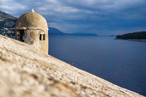 istock Watchtower along the fortress of Dubrovnik along the ocean, Croatia 1069087724