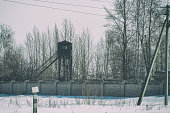 istock Watchtower at the fence with barbed wire 1199178280