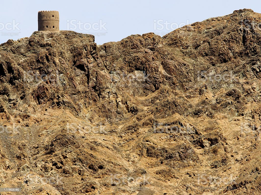 Watchtower with interesting rock stock photo