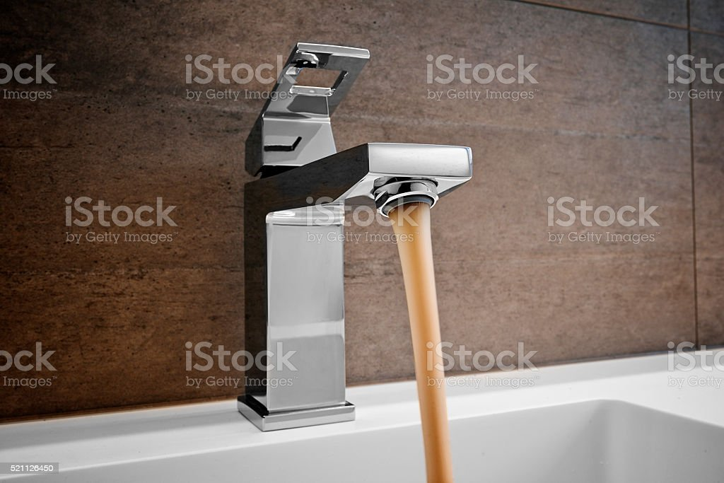 Water and droplets in sink stock photo