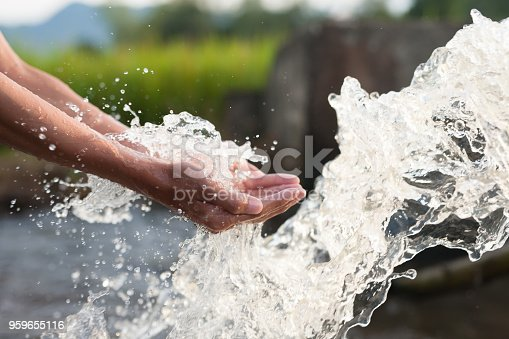 istock Water and hand cupped with conservation and sustainable concept. 959655116