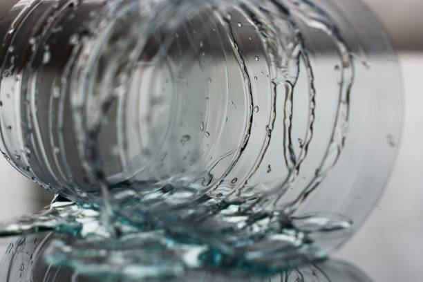 Water and plastic bottle on table. Water and plastic bottle on table. water wastage stock pictures, royalty-free photos & images