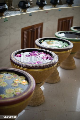 water basin style and flower candle, religion buddhism culture.