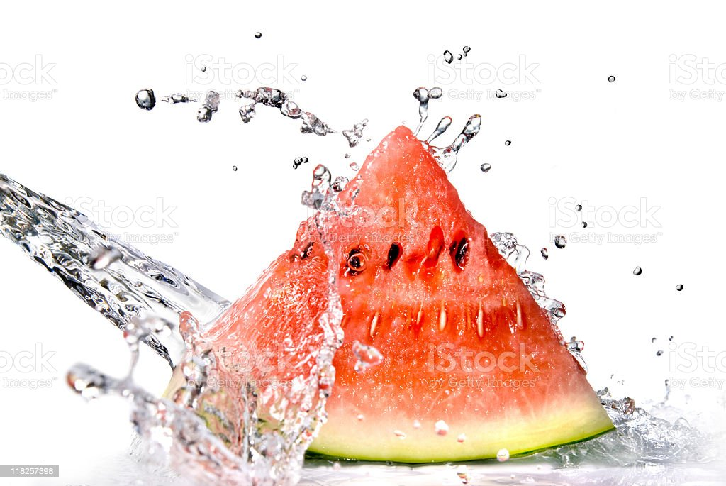 Water being sprayed onto a watermelon slice royalty-free stock photo