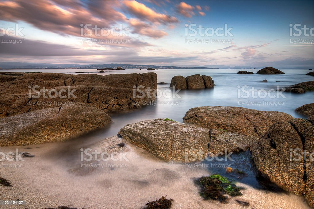 Water between the rocks of a beach stock photo