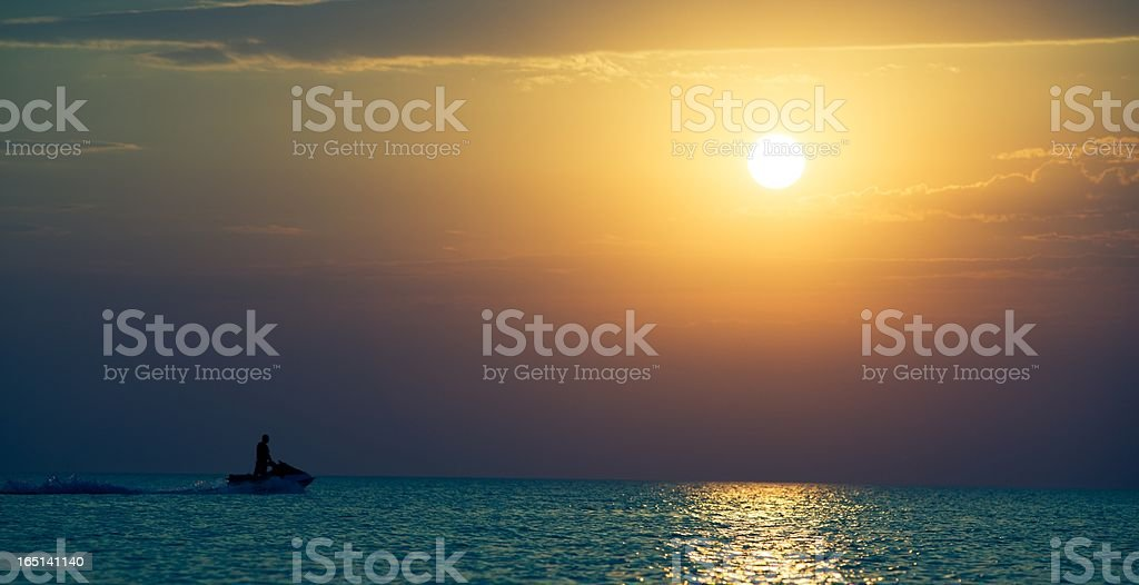 Water biker at sunset royalty-free stock photo