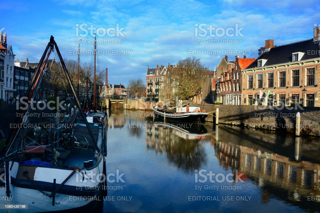 Water, boat and traditional buildings in Rotterdam stock photo