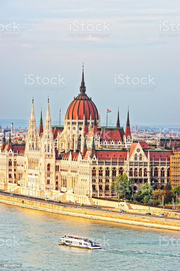 Water boat at Danube River and Hungarian Parliament House stock photo