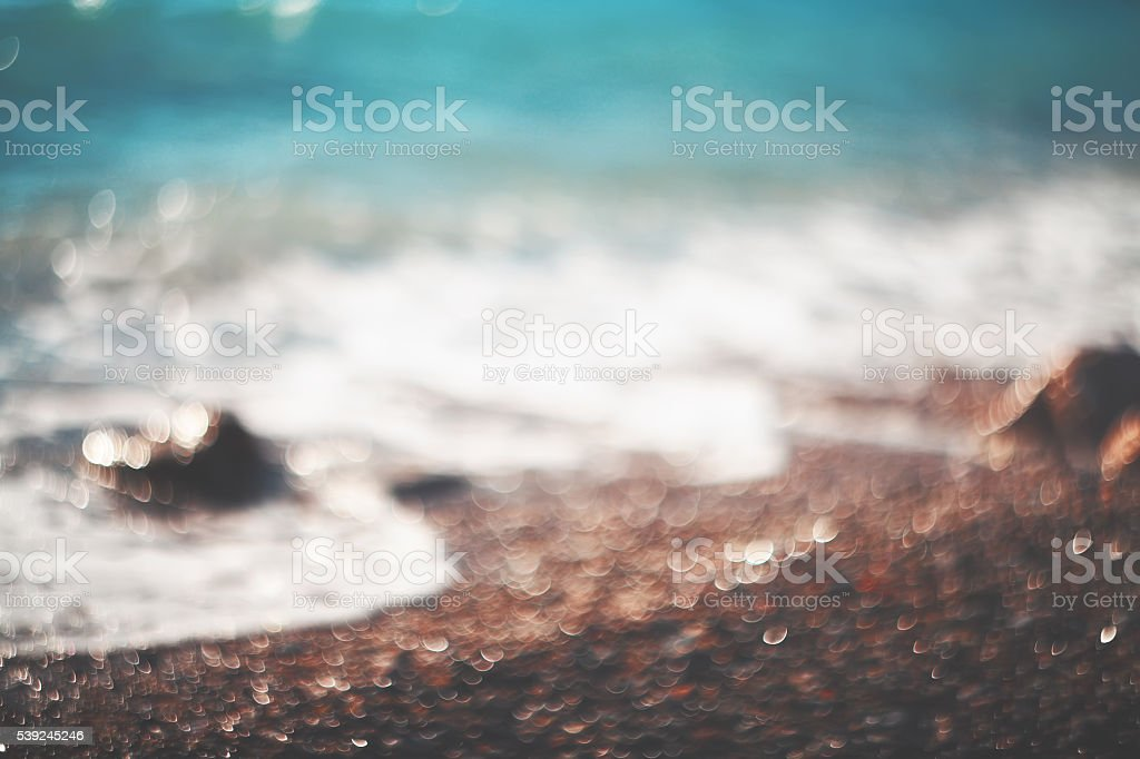 Water bokeh lights on the coastline.Natural background. royalty-free stock photo
