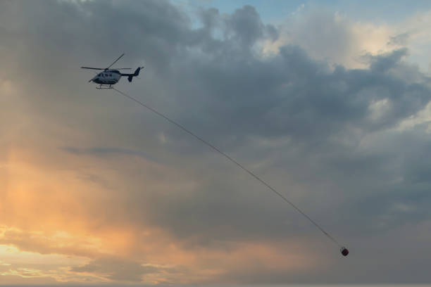 Water bombing fire fighting helicopter in action in Australia stock photo