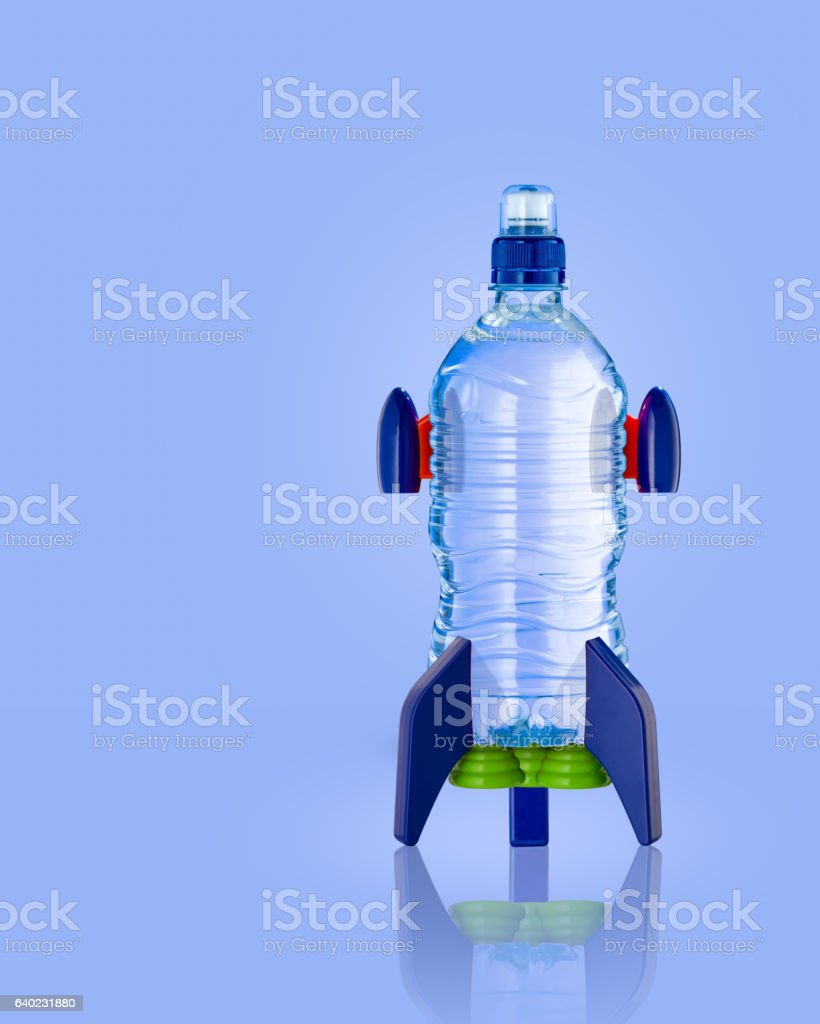 Water bottle in the form of a rocket on blue stock photo