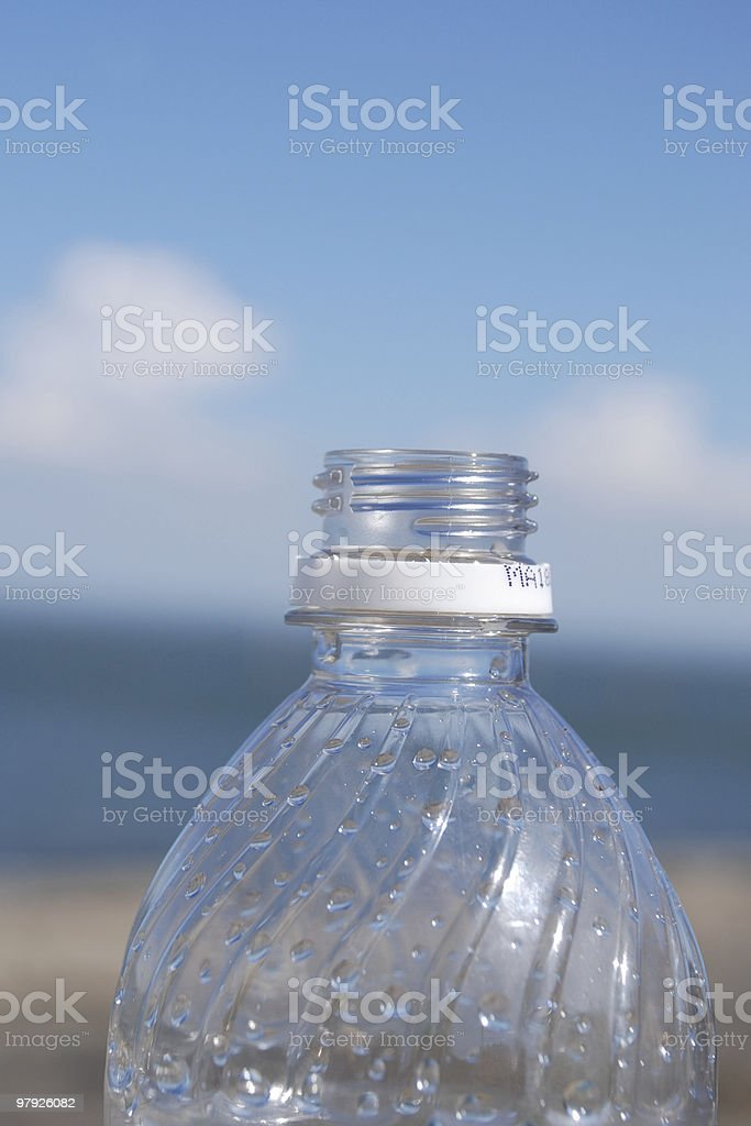 water bottle on a beach royalty-free stock photo
