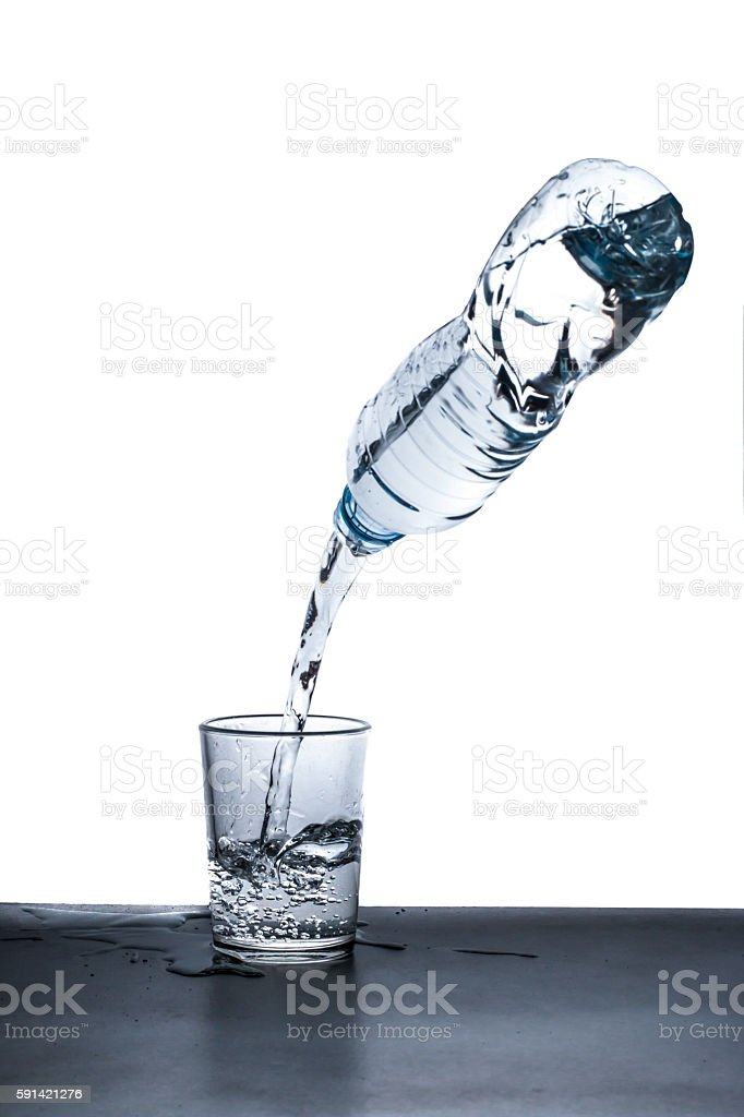 water bottle pour water to glass on white background stock photo