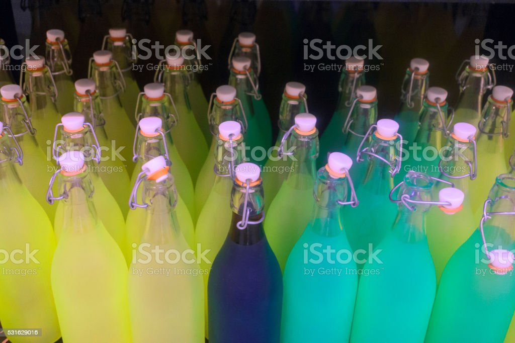 water bottles with pink lids stock photo