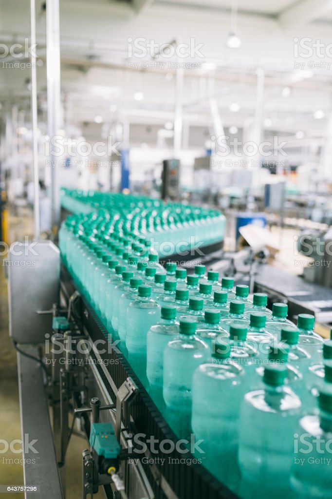 Water bottling factory interiors and machinery. stock photo