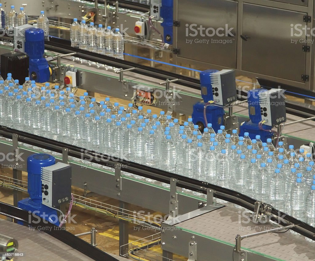 Water bottling factory with bottles on conveyor stock photo