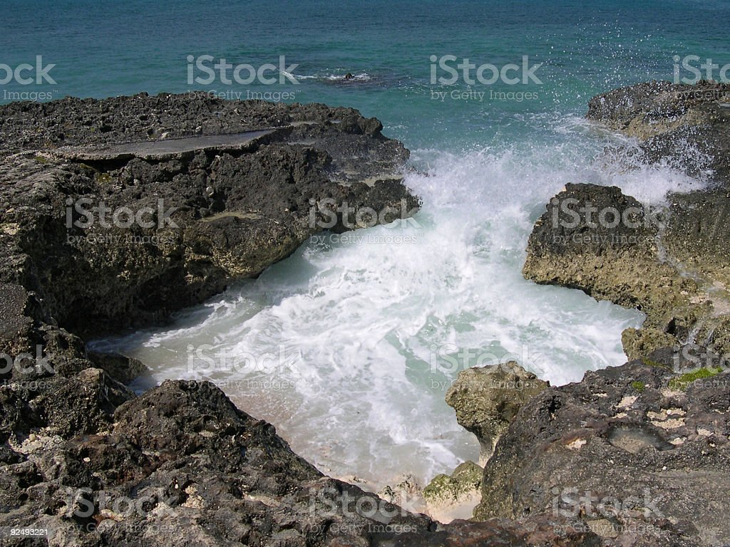 Water Breaking Against Coral royalty-free stock photo